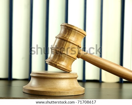 Judge 's Gavel and stack of legal books - stock photo