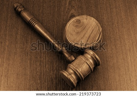Judge's gavel on wooden table - stock photo