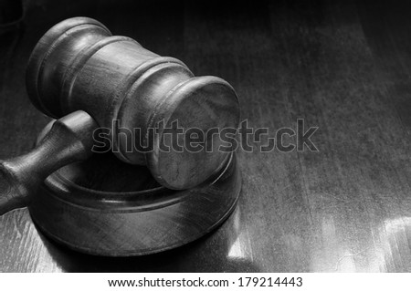 Judge's gavel on wooden table with space for text - stock photo