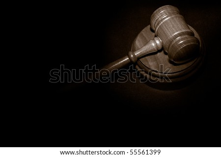 judge's legal gavel on a law book - stock photo