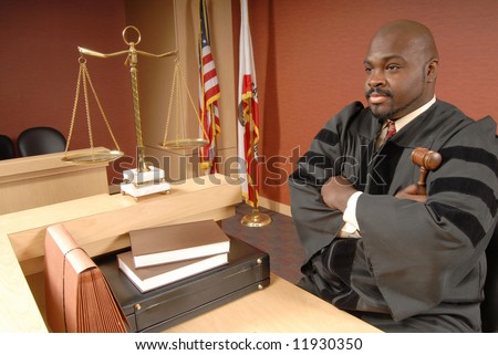 Judge sitting at the bench and listening to arguments - stock photo