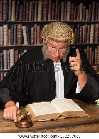 Judge with wig and gavel holding a speech to the convicted criminal - stock photo
