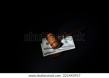 Judges court gavel and hundred dollar bills                                - stock photo