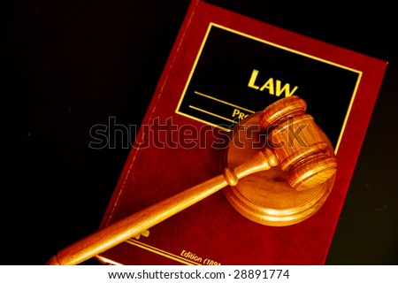 judges court gavel on a law book, from above - stock photo