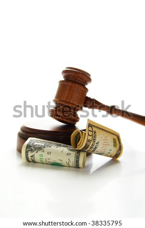 judges court gavel with money (law suit) - stock photo
