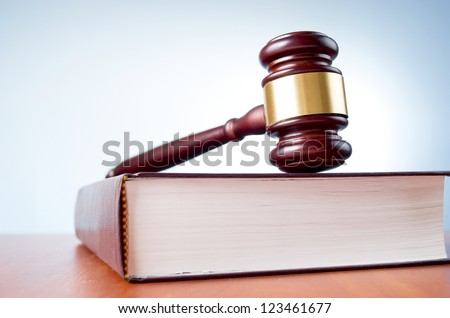 judges gavel and law book on a blue background - stock photo