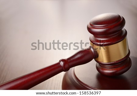 judges gavel on a brown table - stock photo