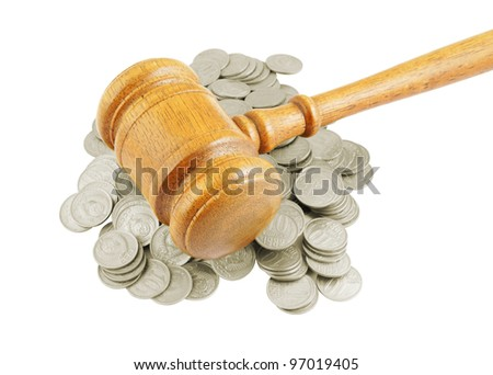 Judges gavel on coins isolated on white - stock photo