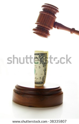 judges law gavel about to pound money, on white - stock photo
