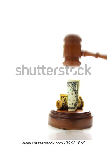 judges law gavel about to pound on money - stock photo