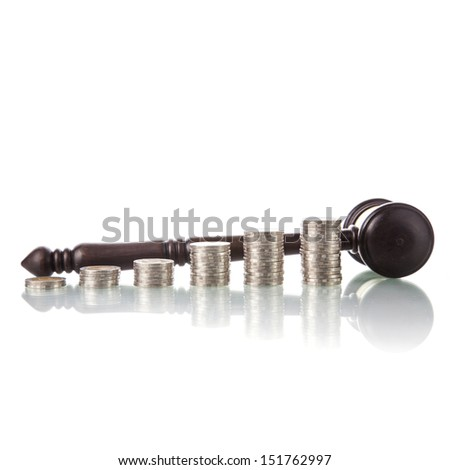 judges law gavel with coins - stock photo