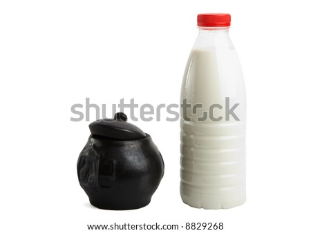 Jug and bottle with milk - stock photo