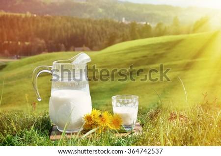 Jug of milk. Emmental region, Switzerland - stock photo