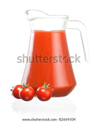 Jug of tomato juice and three fruits with green leaves isolated - stock photo