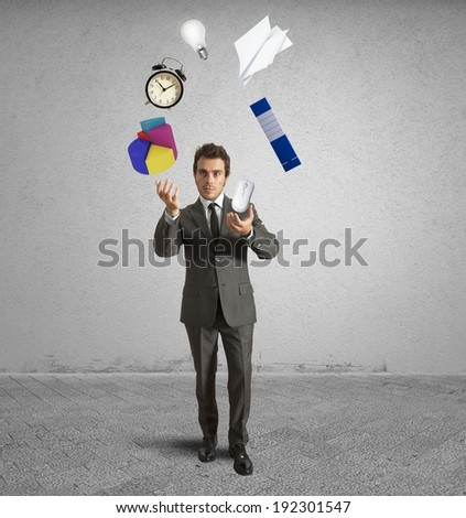 Juggler businessman playing with business object - stock photo