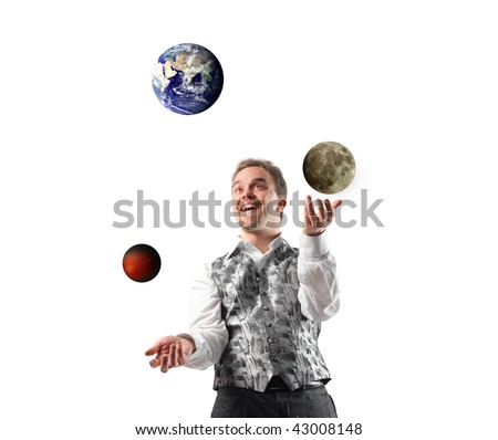 juggler playing with planets - stock photo