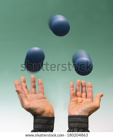 juggler with blue balls - stock photo