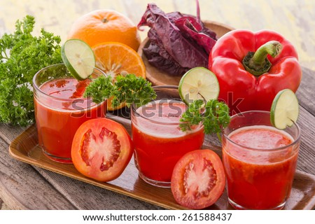 juice combining red paprika, tomato and red spinach - stock photo