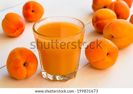Juice freshly squeezed from ripe summer apricots - stock photo