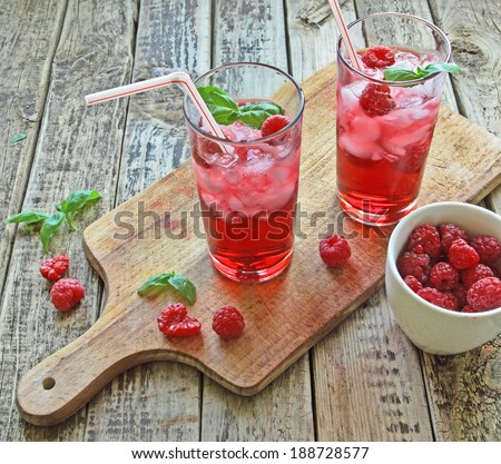 Juice from fresh rasberries with ice drink - stock photo