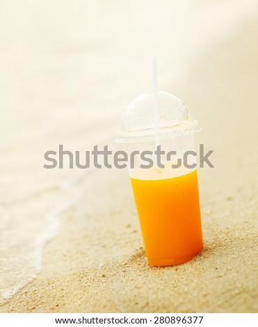 Juice on the beach - stock photo