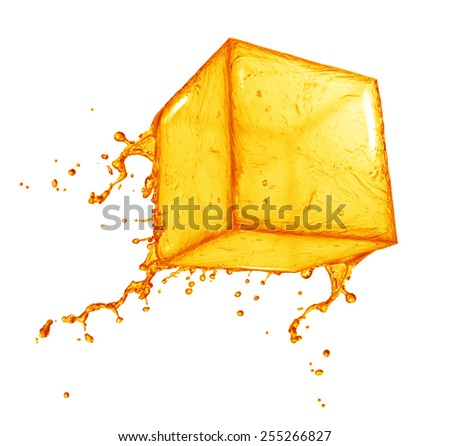 Juice splash cube - stock photo