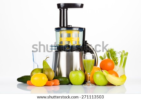 juicer with fruit, vegetables and a glass of juice on white table with white background, for a healthy lifestyle - stock photo
