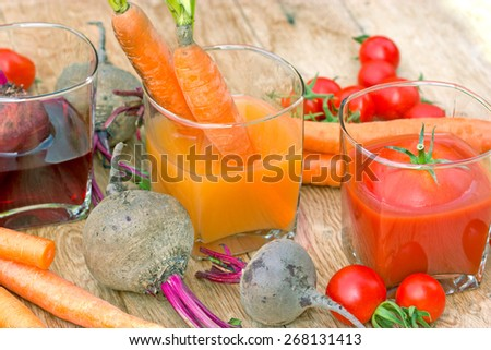 Juices from organic vegetables - freshly squeezed - stock photo