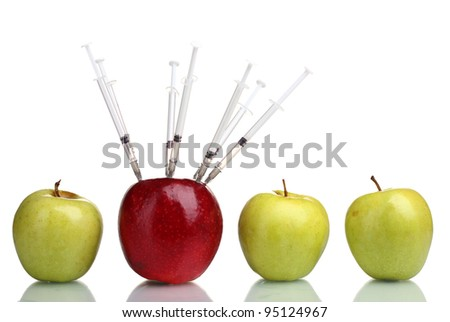 juicy apples and syringes isolated on white - stock photo
