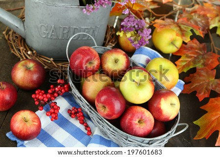 Juicy apples in basket on table close-up - stock photo
