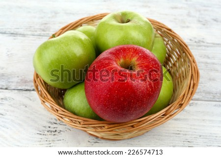 Juicy apples on wooden table - stock photo