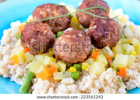 Juicy beef meat balls and couscous in the plate,selective focus  - stock photo