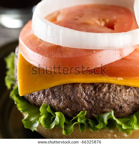 juicy cheeseburger  (note-selective focus) - stock photo