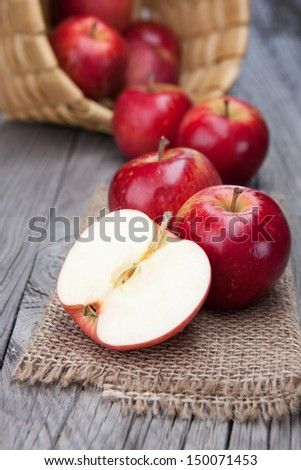 Juicy fresh apples on dark wooden background - stock photo
