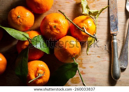 Juicy, fresh clementines against a wooden background.