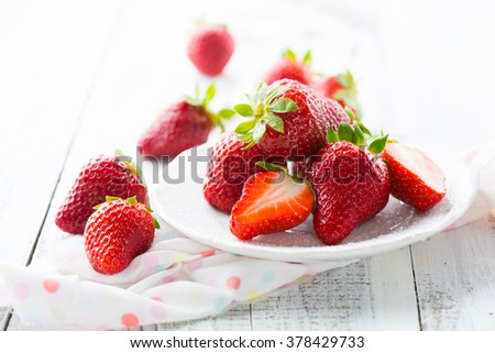 Juicy fresh strawberries on an old white wooden background, selective focus - stock photo