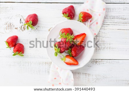 Juicy fresh strawberries on an old white wooden background, top view - stock photo