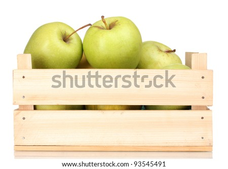 juicy green apples in a wooden crate isolated on white - stock photo