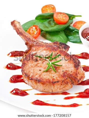 Juicy grilled pork fillet steak with greens - stock photo