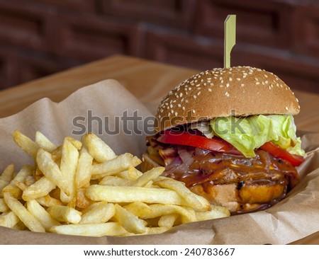Juicy Hamburger with fries  - stock photo