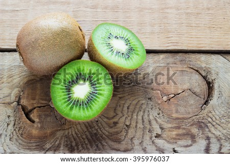 Juicy kiwi fruit on wooden  background view from above - stock photo