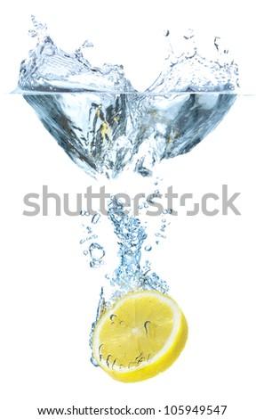 Juicy lemon and water splash. Tasty and healthy food - stock photo