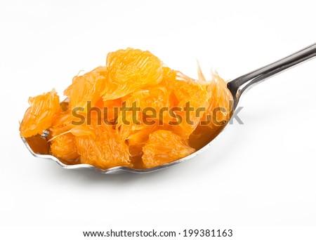 Juicy orange pulp in a spoon - stock photo