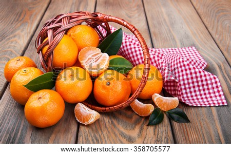 Juicy orange tangerines on a old wooden table - stock photo