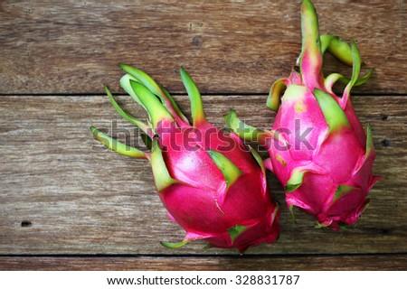Juicy pink pitaya on wooden table closeup  - stock photo
