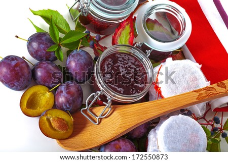 Juicy plums and fresh homemade jams  - stock photo