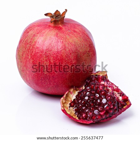 Juicy pomegranate on a white background - stock photo