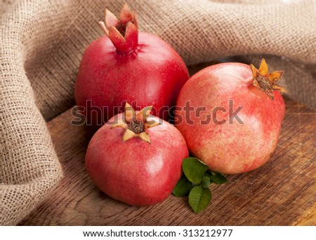 Juicy pomegranates on wood - stock photo
