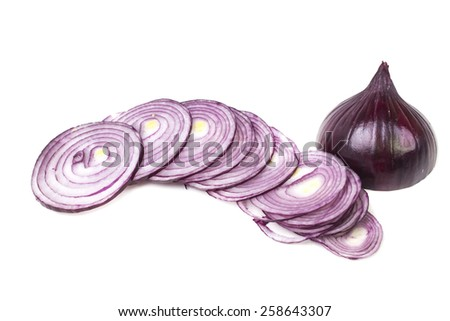 Juicy slices of fresh sliced red onion - stock photo
