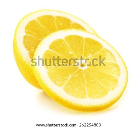 Juicy slices of lemon isolated on white - stock photo
